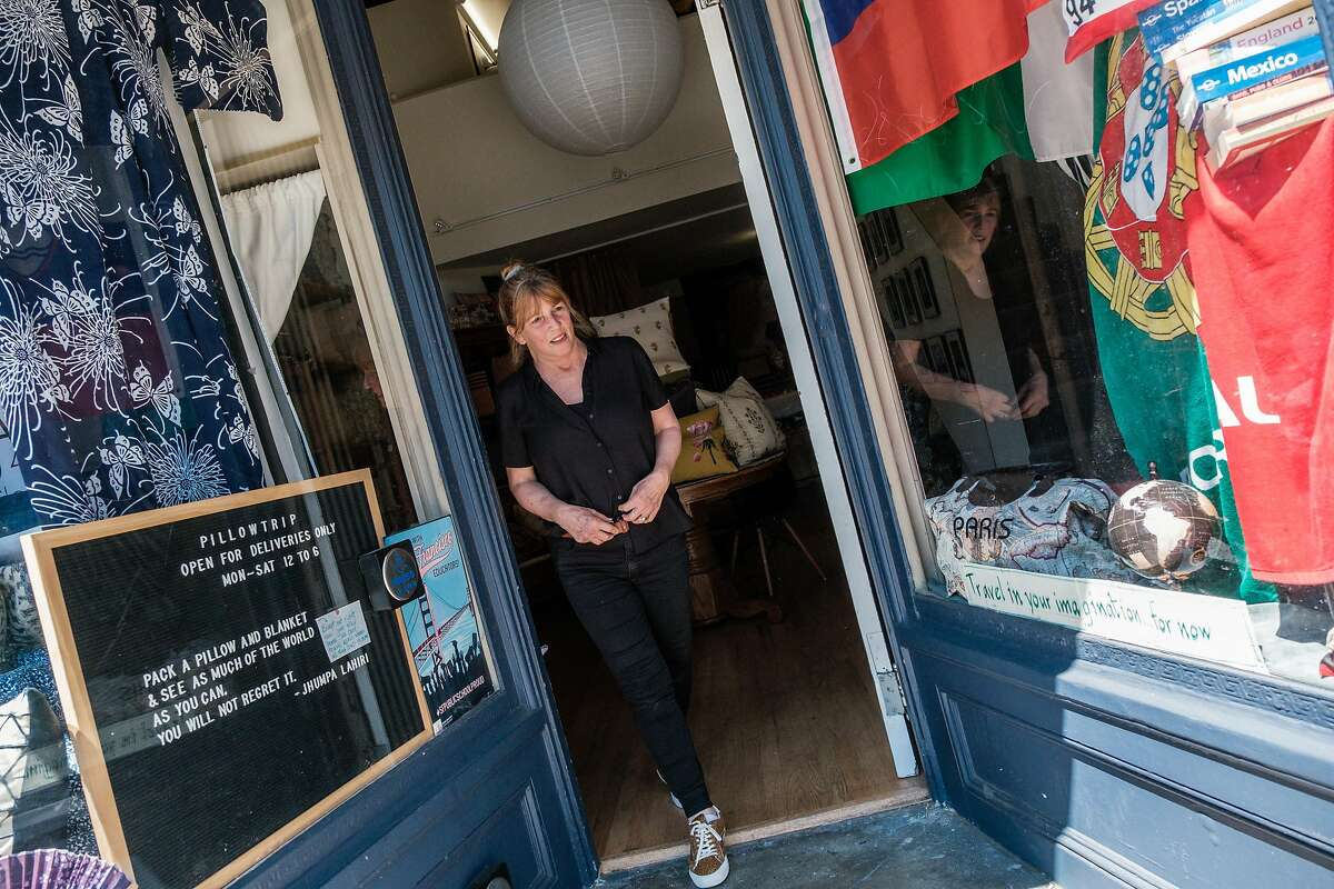 Francis Wolff stands in the door way to her shop, Pillowtrip, in North beach in San Francisco on Thursday, May 28, 2020.