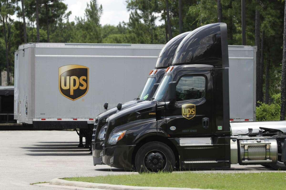 Trucks at the UPS Conroe Customer Center are seen, Wednesday, May 27, 2020, in Conroe. The company is encouraging community members to make signs and line up on Pozos Lane June 5 at 8:45 a.m. in support of its workers at their customer center facility.