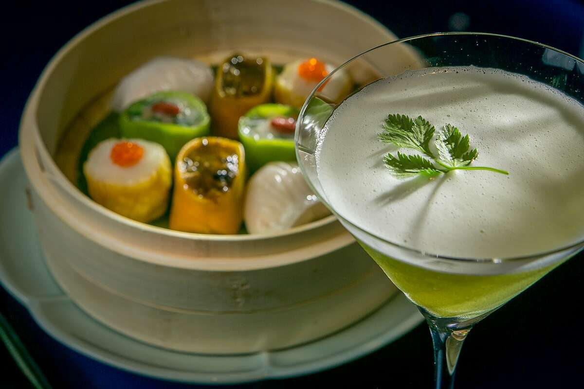 """The """"Zesty Martini"""" with the Hakka steamed Dim Sum platter at Hakkasan in San Francisco, Calif., is seen on Thursday, June 27th, 2013."""