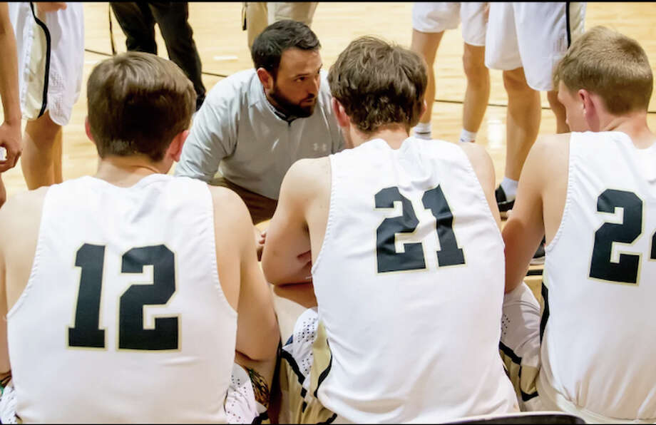 Todd Warren, who was recently promoted to Andrews head boys basketball coach, speaks to his players during a Mustangs basketball game. Andrews ISD photo