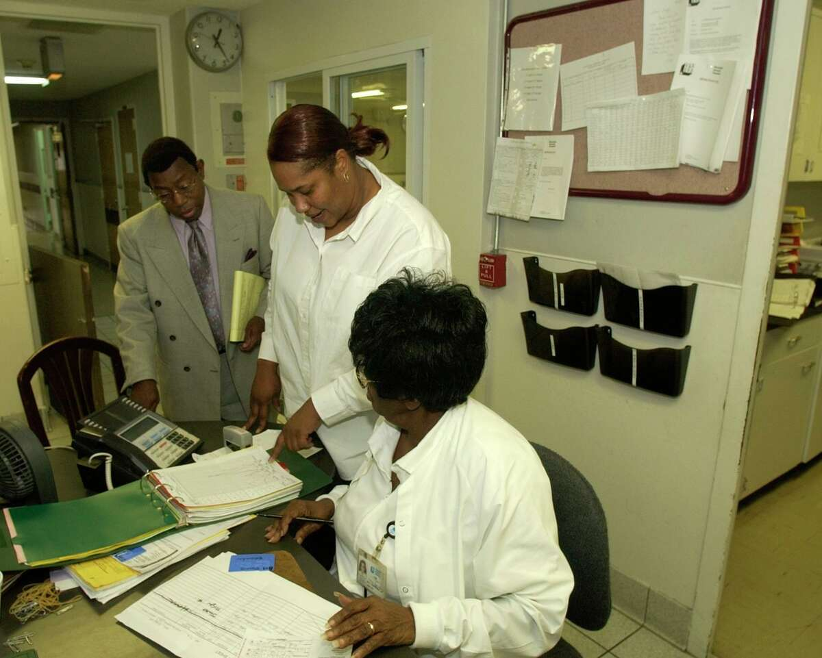 Riverside General Hospital, an independent community hospital once known as Negro Hospital of Houston, was administered by Earnest Gibson III since the early 70s. He is seen with counselor Robin Highsmith, and nurse Mary Nylander on Sept. 27, 2004. Chronicle/Ben DeSoto