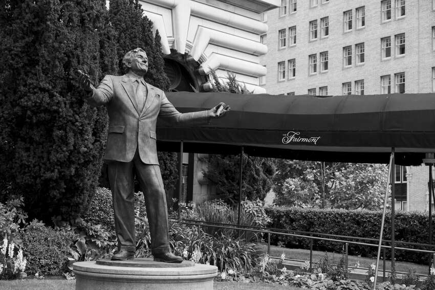 A statue of singer Tony Bennett stands outside the closed Fairmont Hotel in San Francisco on April 17, 2020.