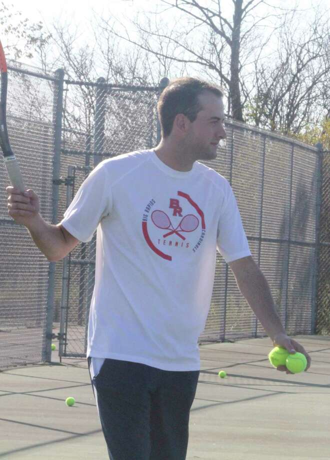 Big Rapids tennis coach Austin Brinker gets set to hit some tennis balls during a clinic last summer. (Pioneer file photo)