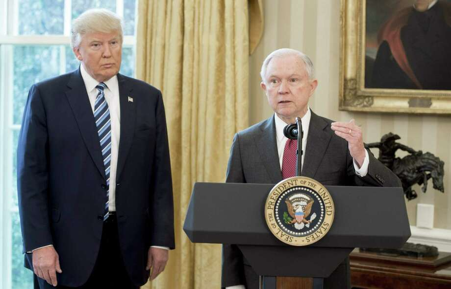 (FILES) In this file photo taken on February 9, 2017 US President Donald Trump stands alongside US Attorney General Jeff Sessions after Sessions was sworn in, in the Oval Office of the White House. - US Attorney General Jeff Sessions lashed back on July 23, 2018 at increasing pressure from President Donald Trump, declaring the Department of Justice would not bow to politics. The words came after Justice Department prosecutors won convictions of two former top Trump aides, Paul Manafort and Michael Cohen, in high-profile cases that raised fresh questions over Trump's behavior before he was elected in November 2016. (Photo by SAUL LOEB / AFP)SAUL LOEB/AFP/Getty Images Photo: SAUL LOEB, Contributor / AFP/Getty Images / AFP or licensors
