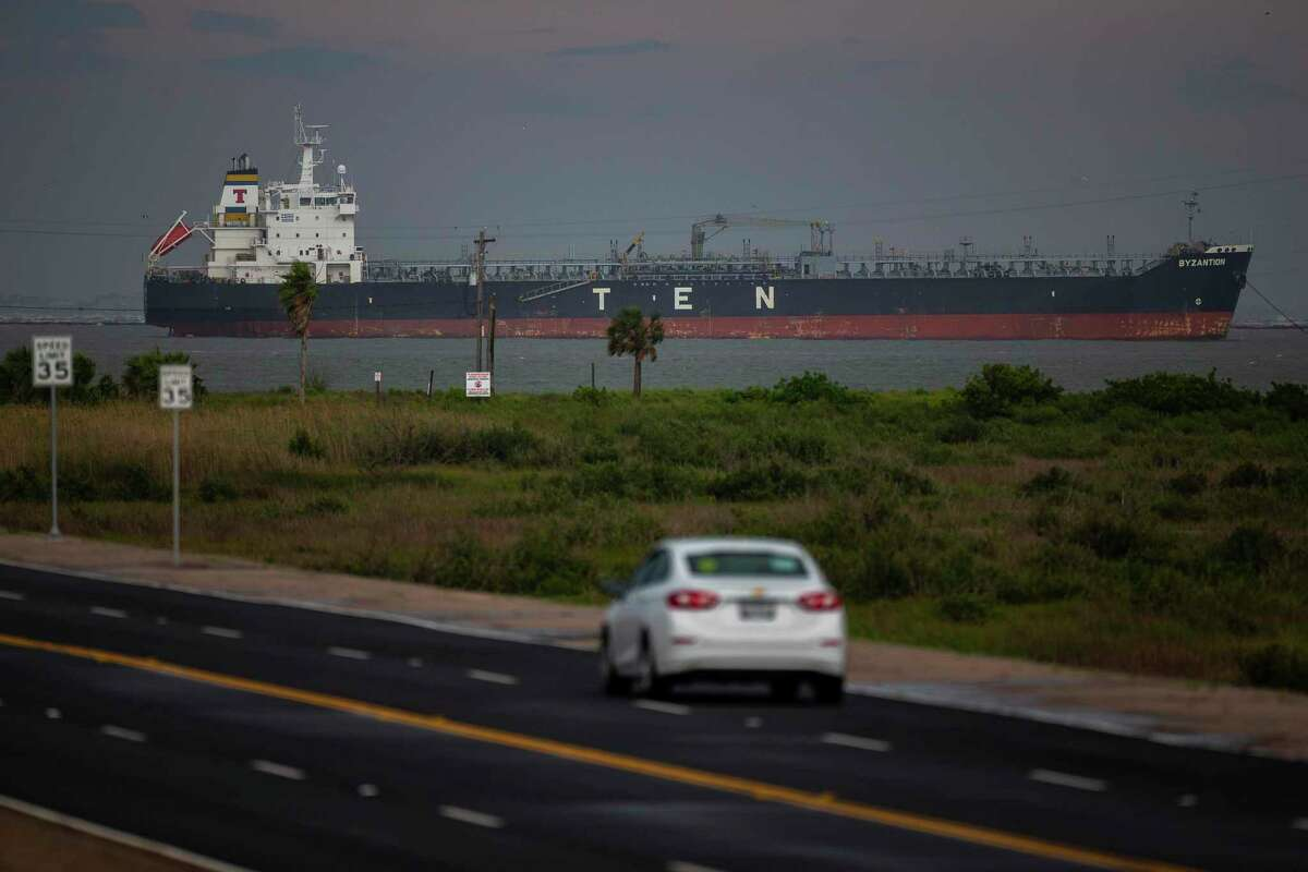 An oil tanker sits offshore between Galveston Bay and the Gulf of Mexico seen from Seawall Boulevard, Friday, May 15, 2020, off of the east end of Galveston Island.