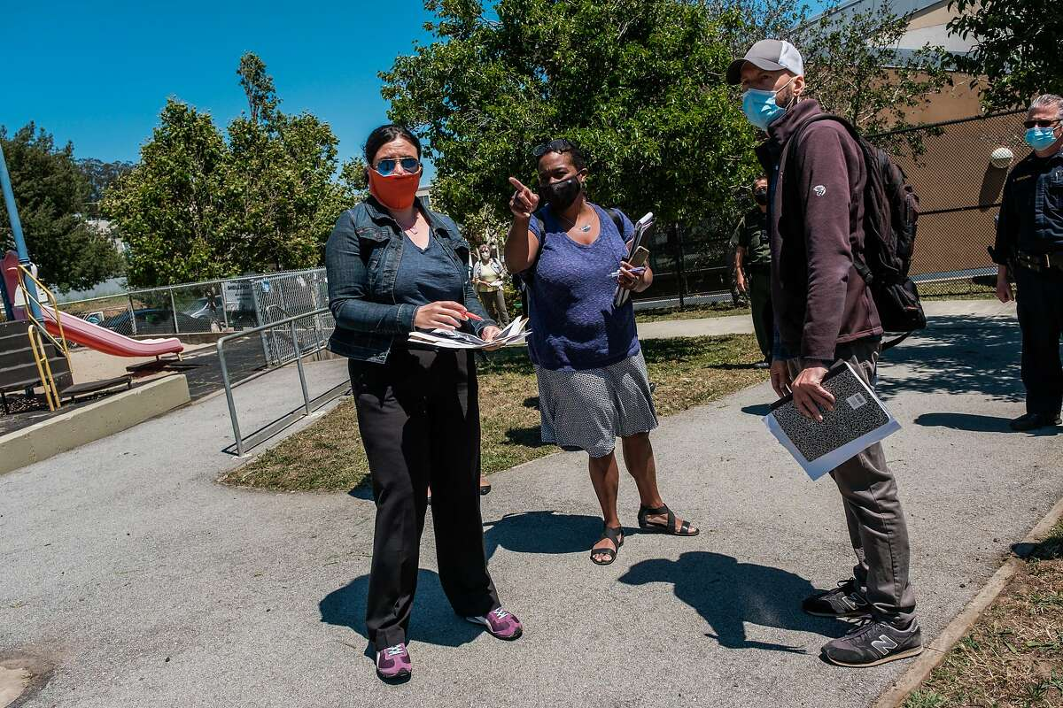 Dr. Kim Rhoads, center, inspects Herz Playground in Visitacion Valley along with other community organizers and consultants in San Francisco on Thursday, May 28, 2020. The playground will be where UCSF and SFDPH are launching a testing surveillance program this weekend
