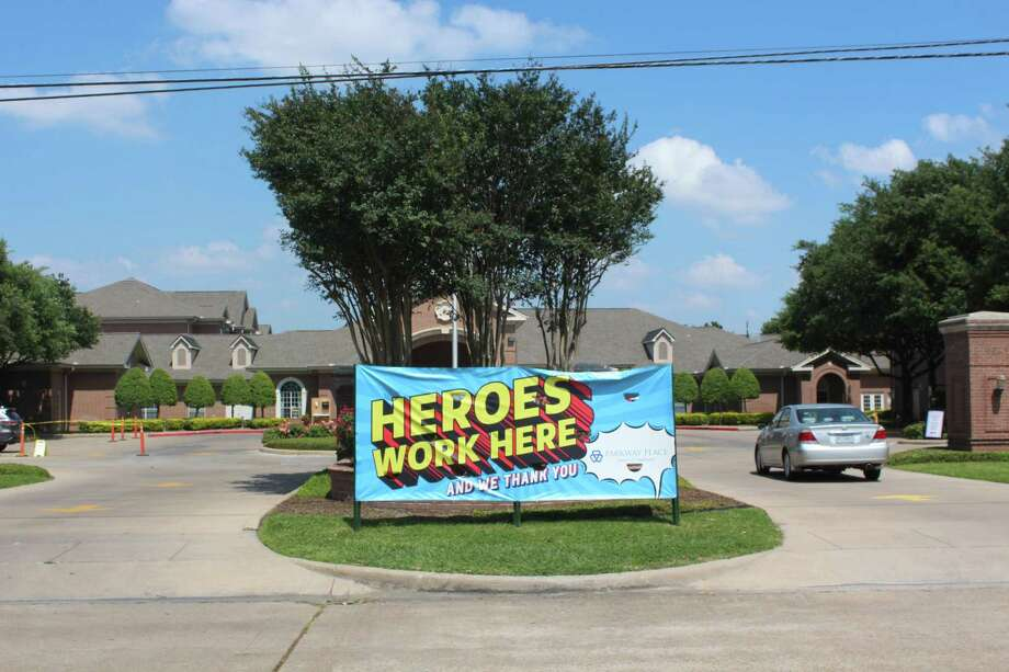 """""""Heroes Work Here"""" is the banner at the entrance of Buckner Parkway Place, a senior living facility that has been under strict visitation rules since March. Photo: RALPH NICKERSON"""