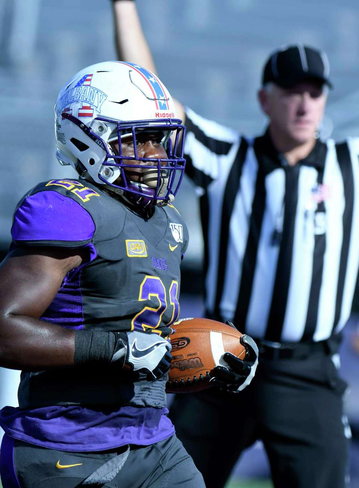 University at Albany running back Karl Mofor (21) scores a touchdown against Lafayette during the first half of an NCAA college football game Saturday, Sept. 21, 2019, in Albany, N.Y. (Hans Pennink / Special to the Times Union)