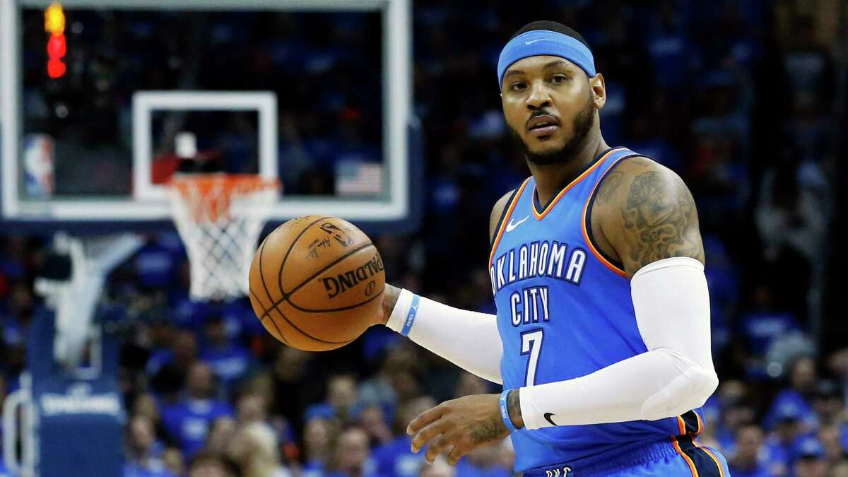 FILE - This is an April 25, 2018, file photo showing Oklahoma City Thunder forward Carmelo Anthony (7) during Game 5 of an NBA basketball first-round playoff series against the Utah Jazz, in Oklahoma City. Carmelo Anthony is done in Oklahoma City. A person with knowledge of the details tells The Associated Press the Thunder are sending the veteran NBA forward and a 2022 protected first-round pick to Atlanta in exchange for Hawks guard Dennis Schroder and Mike Muscala. (AP Photo/Sue Ogrocki, File)
