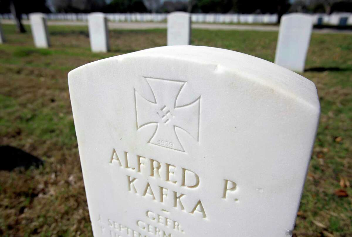 The headstone for World War II prisoner of war Alfred P. Kafka, seen in 2012 at Fort Sam Houston National Cemetery, bears an Iron Cross and swastika, a military decoration modified by the Nazis in 1933. Some 141 POWs are interred at the cemetery.
