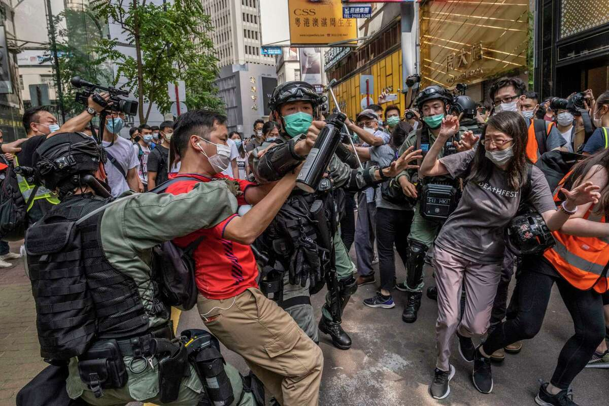 Riot police officers clash with protesters in Hong Kong, on Wednesday, May 27, 2020. China officially has the broad power to quash unrest in Hong Kong, as the countrya€™s legislature on Thursday nearly unanimously approved a plan to suppress subversion, secession, terrorism and seemingly any acts that might threaten national security in the semiautonomous city. (Lam Yik Fei/The New York Times)