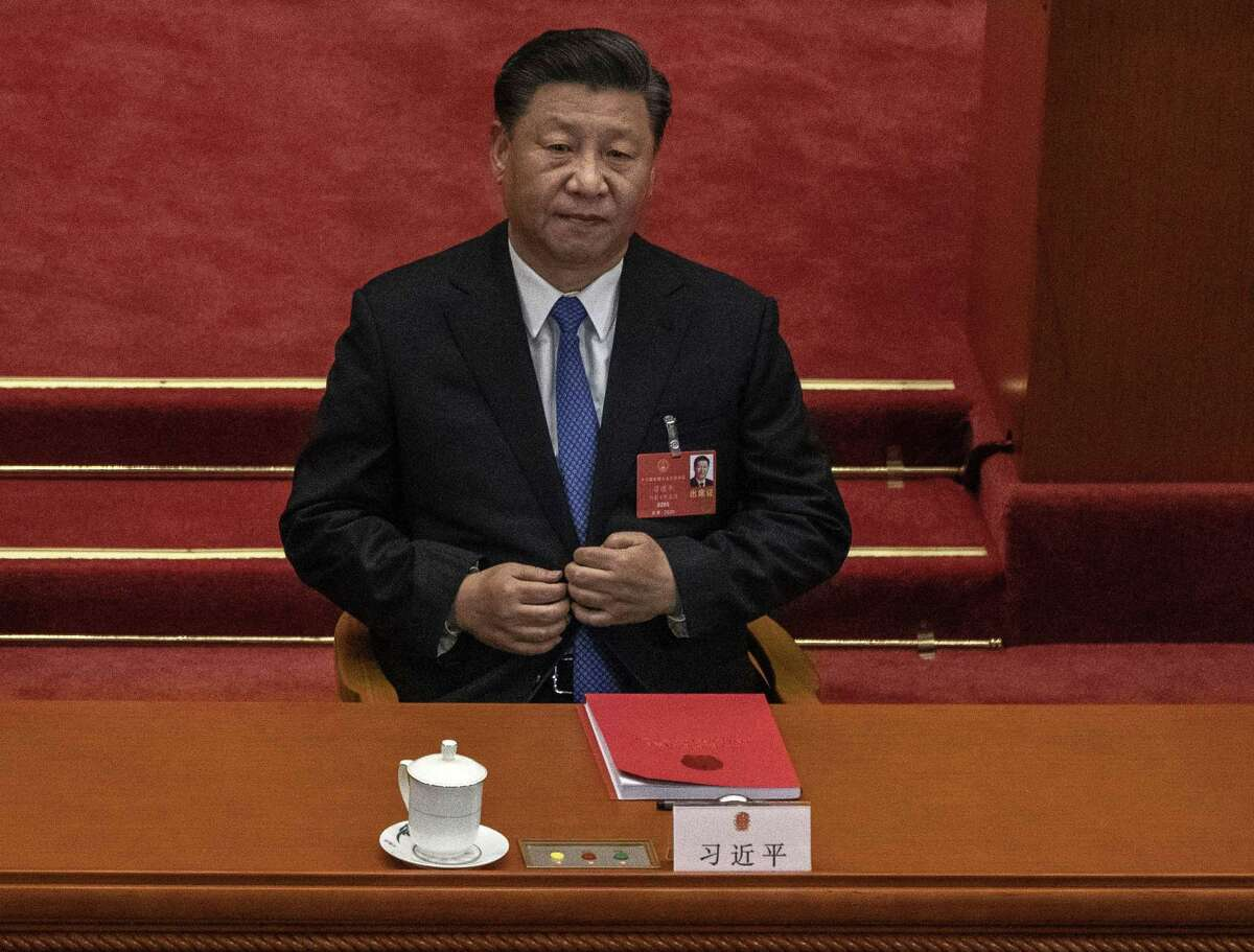 BEIJING, CHINA - MAY 28: Chinese president Xi Jinping listens during the closing session of the National People's Congress, which included a vote on a new draft security bill for Hong Kong, at the Great Hall of the People on May 28, 2020 in Beijing, China. The Chinese government passed the draft by a vote of 2,878 votes to one during the session. The draft law, which has drawn international concern, is set to address issues such as secession, subversion, terrorism, and foreign interference, comes after a year of anti-government protests in the semi-autonomous region. China held its annual parliamentary gathering, known as 'The Two Sessions', at the Great Hall of the People from May 21-28th after being postponed at the height of the coronavirus outbreak in China earlier this year. (Photo by Kevin Frayer/Getty Images)