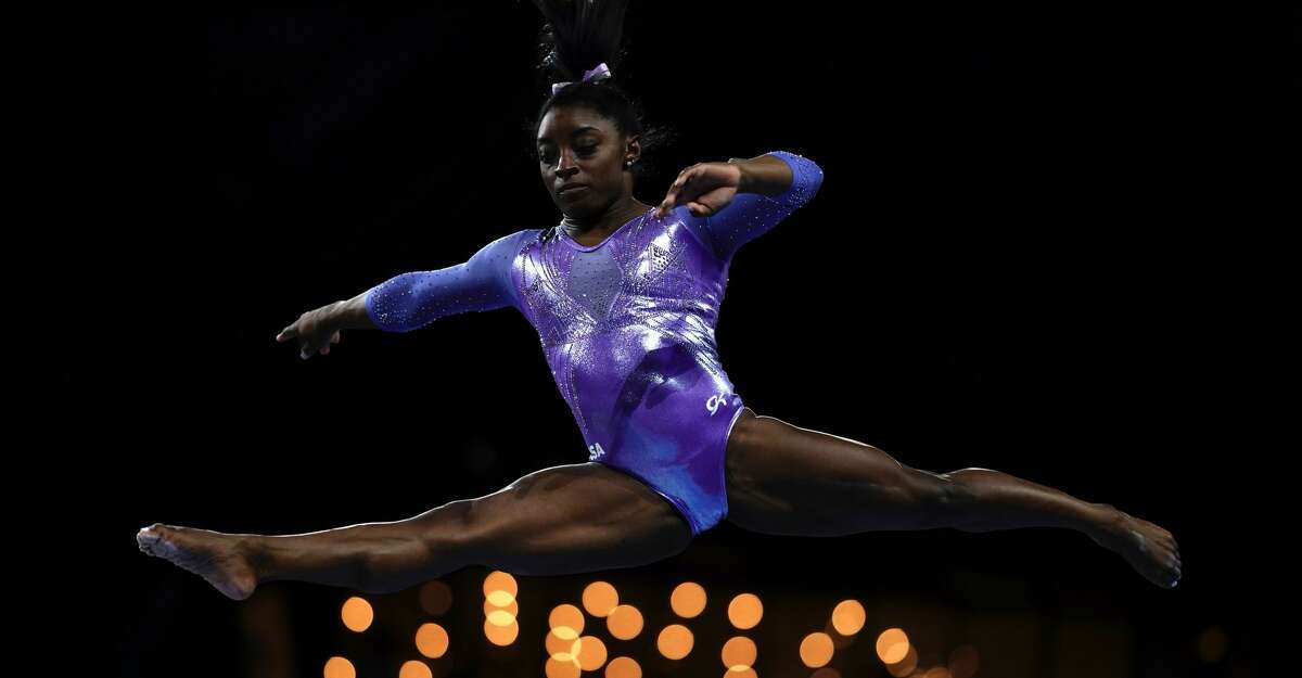 In this file photo USA's Simone Biles performs on the beam during the apparatus finals at the FIG Artistic Gymnastics World Championships at the Hanns-Martin-Schleyer-Halle in Stuttgart, southern Germany, on October 13, 2019. (Photo by LIONEL BONAVENTURE/AFP via Getty Images)