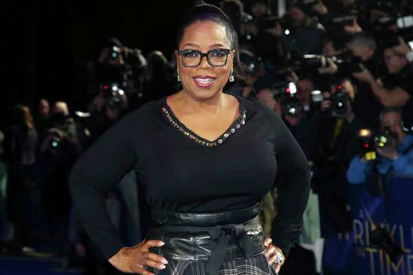 "FILE - In this March 13, 2018, file photo, actress Oprah Winfrey poses for photographers upon arrival at the premiere of the film ""A Wrinkle In Time"" in London. Winfrey announced Wednesday, May 20, 2020 that her Oprah Winfrey Charitable Foundation will donate money to organizations dedicated to helping undeserved communities in Chicago; Nashville, Tennessee; Milwaukee, Wisconsin; and Kosciusko, Mississippi, where she was born. (Photo by Joel C Ryan/Invision/AP, File)"