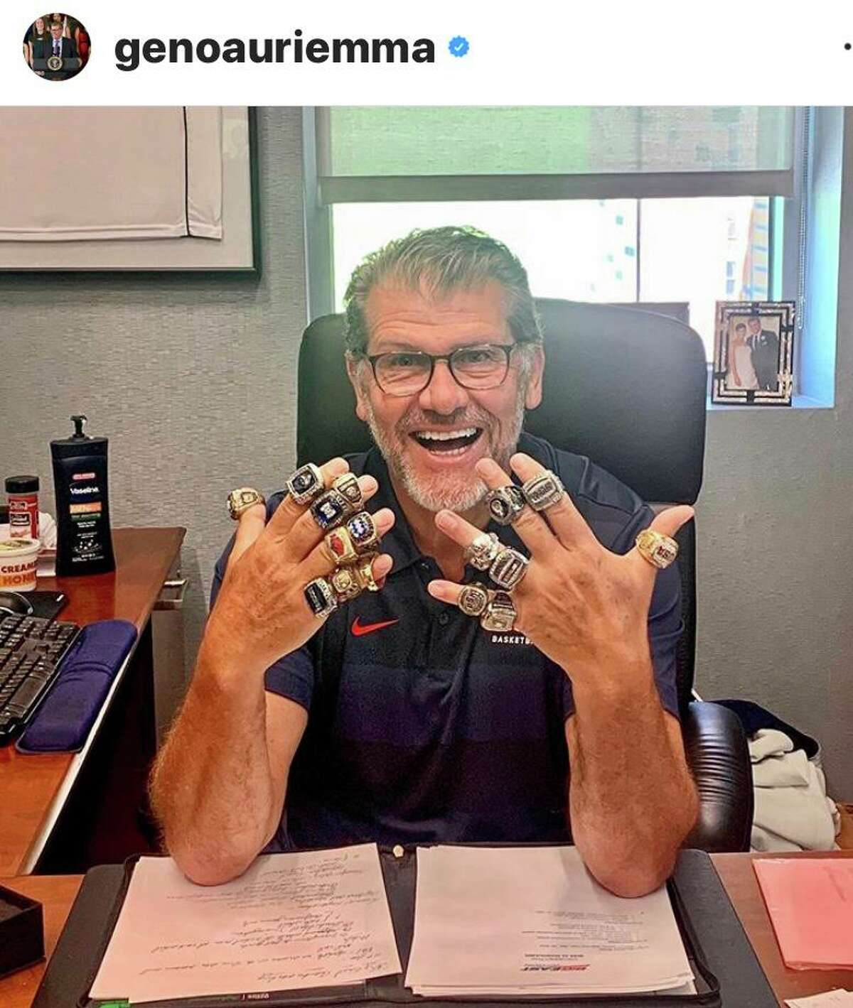 UConn coach Geno Auriemma poses with his championship rings in an Instagram post.