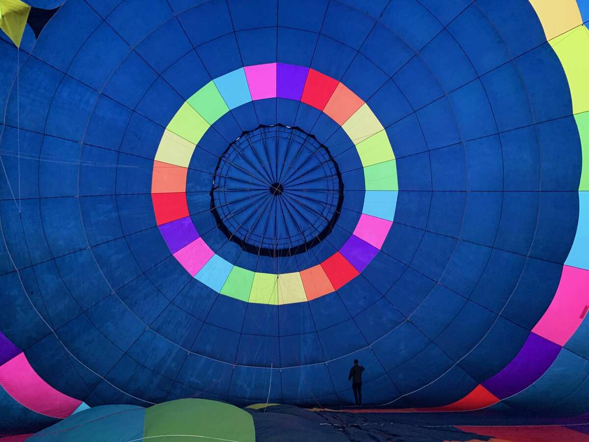Eliav Cohen steps inside his balloon before taking flight.