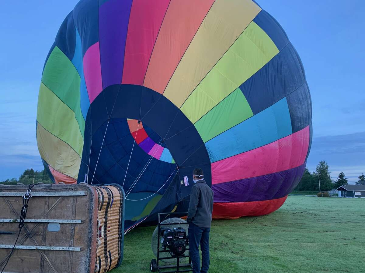 Eliav Cohen watches as his hot air balloon fills up with air before liftoff. Keep clicking through the gallery for more photos of our Seattle Ballooning Expedition. >>>