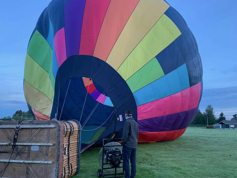 Eliav Cohen watches as his hot air balloon fills up with air before liftoff.