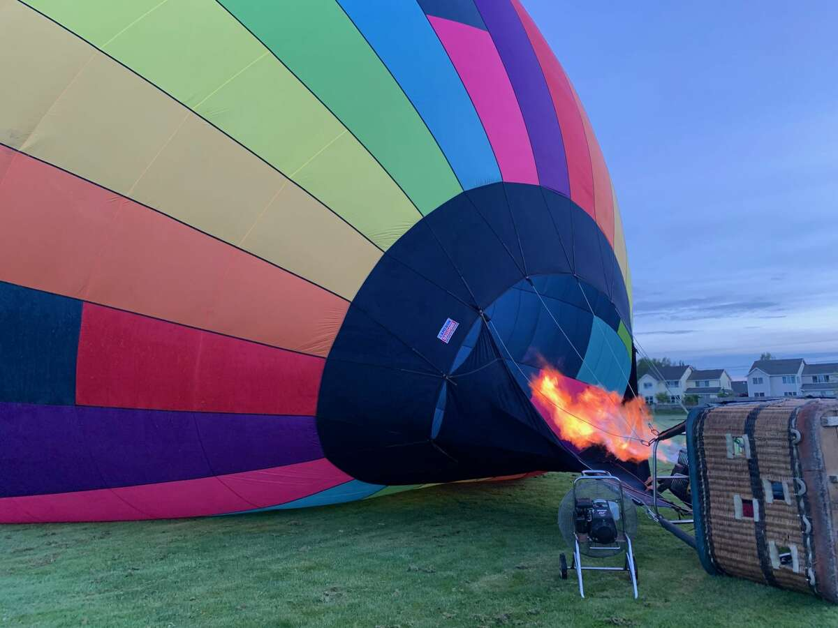 A Seattle Ballooning hot air balloon fills up with heat.
