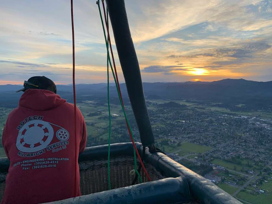 Sean, one of the Seattle Ballooning crew members, looks out over Washington. Photo: Courtesy Seattle Ballooning