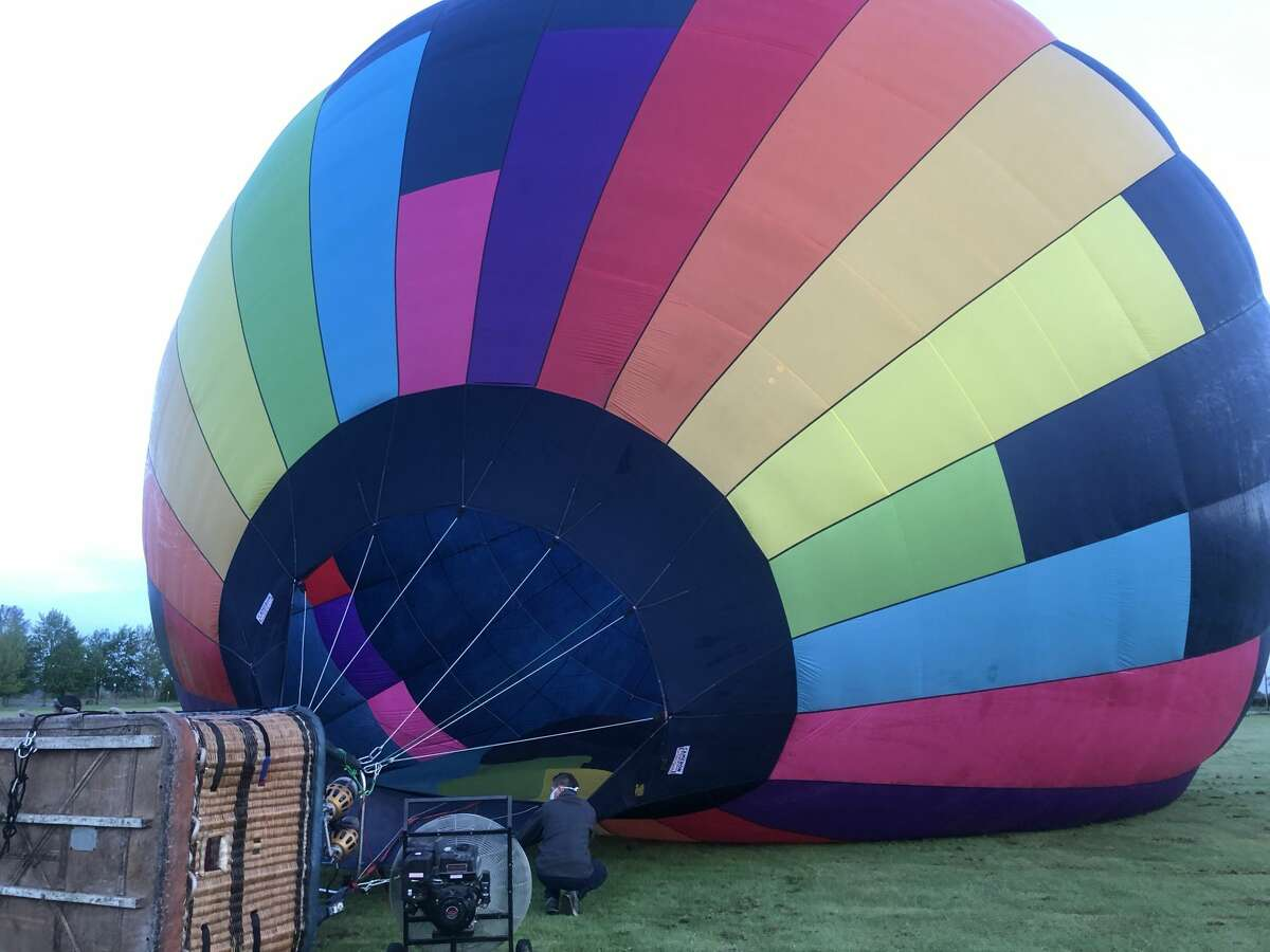 A Seattle Ballooning wicker basket rests on its side before liftoff.