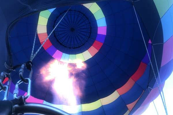 A hot air balloon fills with heat.