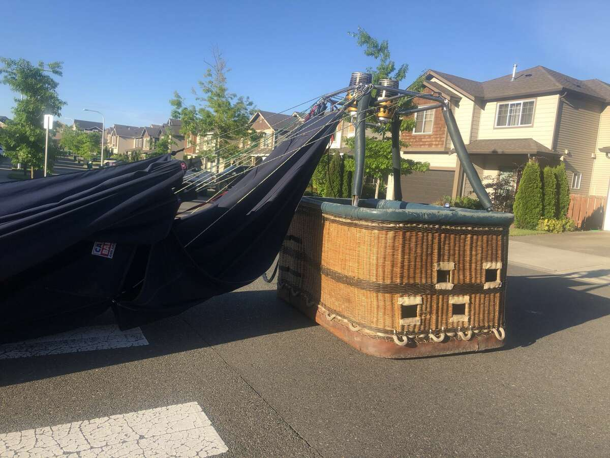 The Seattle Ballooning expedition ends as the basket lands in a nearby neighborhood.