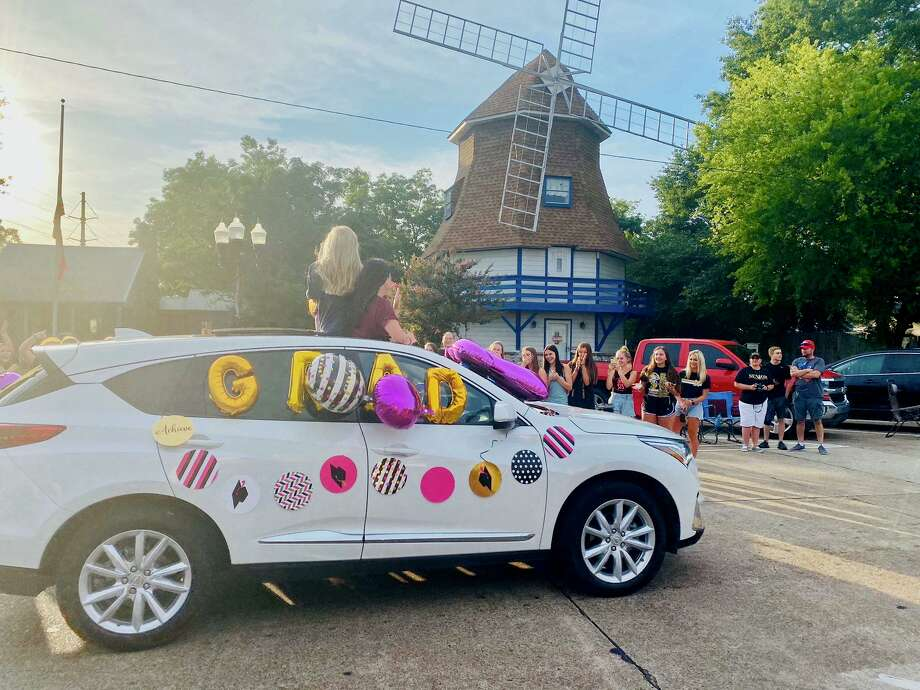 "Parents and fellow students lined Boston Street on Thursday night for Nederland's ""Bulldogs on Boston"" parade, celebrating the class of 2020. Photo: Photo By Matt Faye/The Enterprise / Photo By Matt Faye/The Enterprise/"
