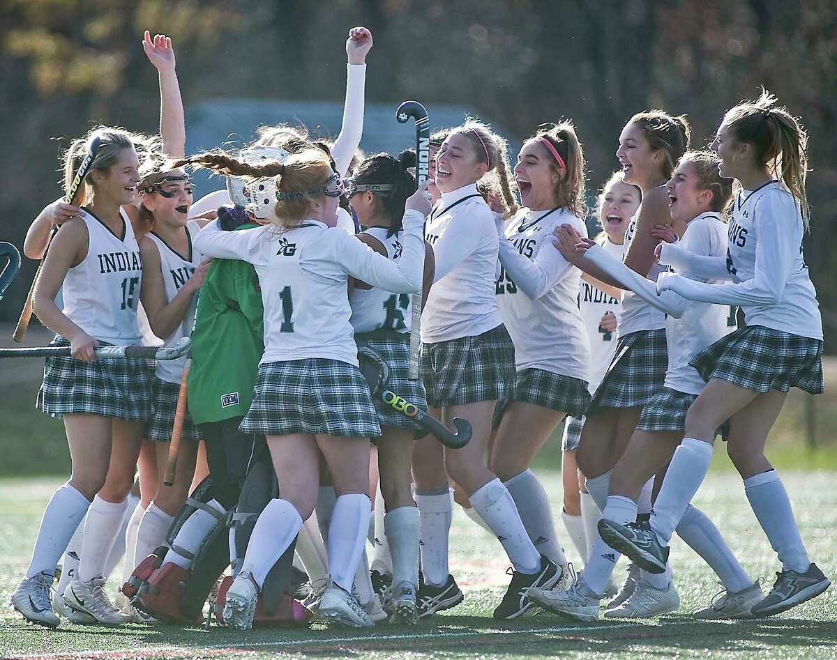 Guilford celebrates its victory in the Class M state championship game against Hand on Nov. 23.