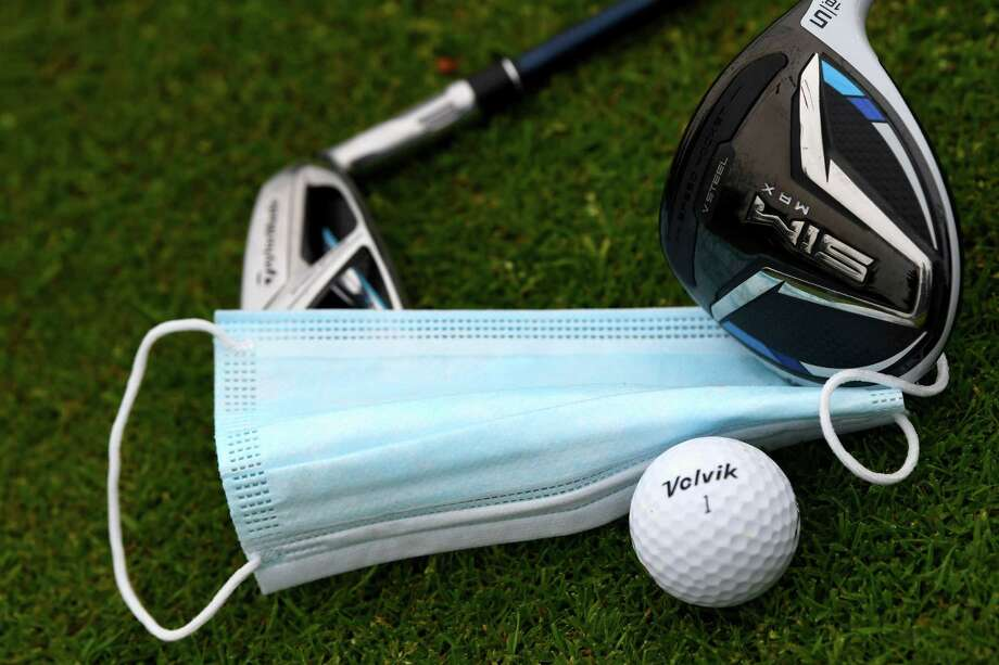 """This illustration shows golf clubs, balls and a facemask at The """"Bluegreen"""" Golf Course in Saint Aubin, south-west of Paris on May 11, 2020, on the first day of France's easing of lockdown measures in place for 55 days to curb the spread of the COVID-19 pandemic, caused by the novel coronavirus. (Photo by FRANCK FIFE / AFP) (Photo by FRANCK FIFE/AFP via Getty Images) Photo: FRANCK FIFE / AFP Via Getty Images / AFP"""