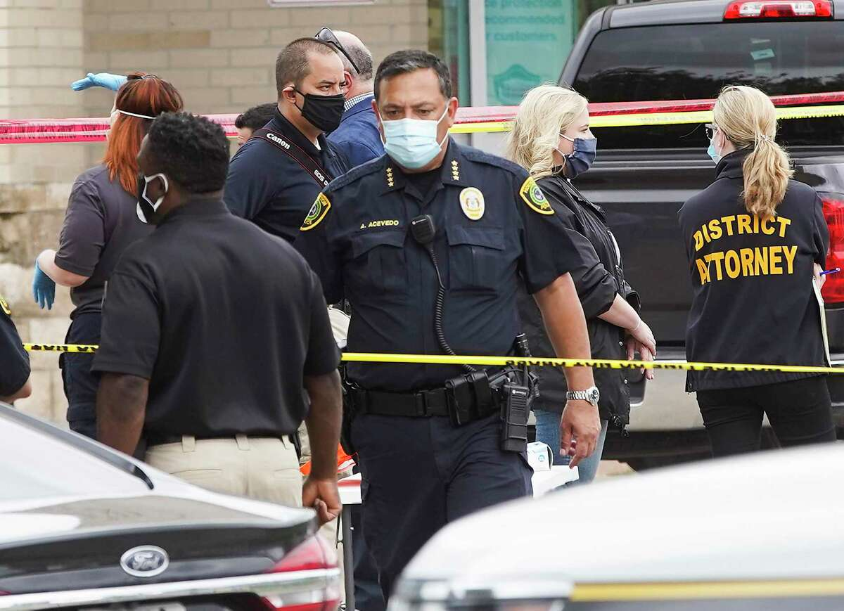 Houston Police Chief Art Acevedo walks through the scene as investigators work an officer-involved shooting in front of the Walgreens on South Braeswood in Houston on Saturday, May 16, 2020. Starting April 21, there have been six fatal shootings by HPD officers.