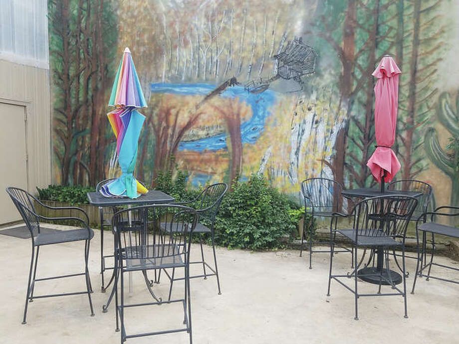 The outside dining area at Verda Mae's restaurant in Waverly features two tables spaced 6 feet apart.