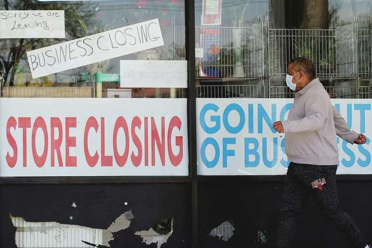 A man looks at signs on a store in Niles that is closed because of the COVID-19 pandemic. A survey of small businesses found most are desperate to reopen after being closed since the end of March.