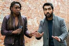 "Issa Rae, left, and Kumail Nanjiana in ""The Lovebirds."" MUST CREDIT: Skip Bolen/Netflix"