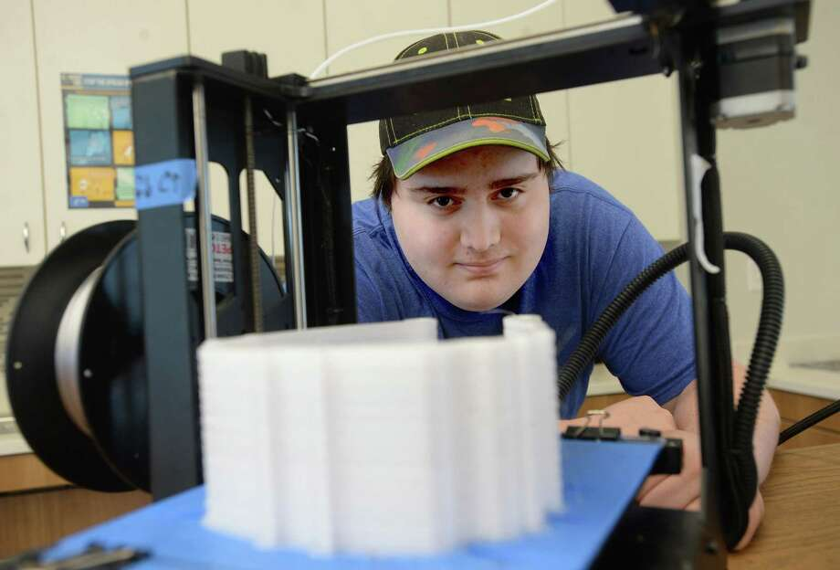 Lamar University student Ian Kennard has been using his time outside of usual courseload to join in a project constructing PPE for doctors and other health care professionals battling the COVID-19 pandemic. He is creating frames for protective face masks on a 3-D printer made available to him from the Makerspace.   Photo taken Friday, April 17, 2020 Kim Brent/The Enterprise Photo: Kim Brent / The Enterprise / BEN