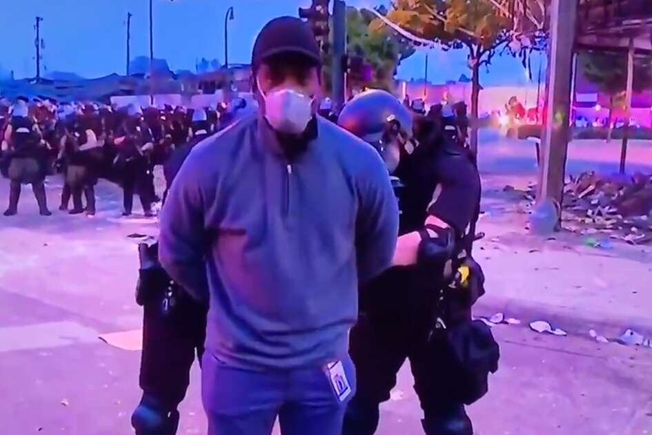 CNN reporter Oscar Jimenez and his crew were arrested by police Friday morning while reporting on protests and unrest in downtown Minneapolis.