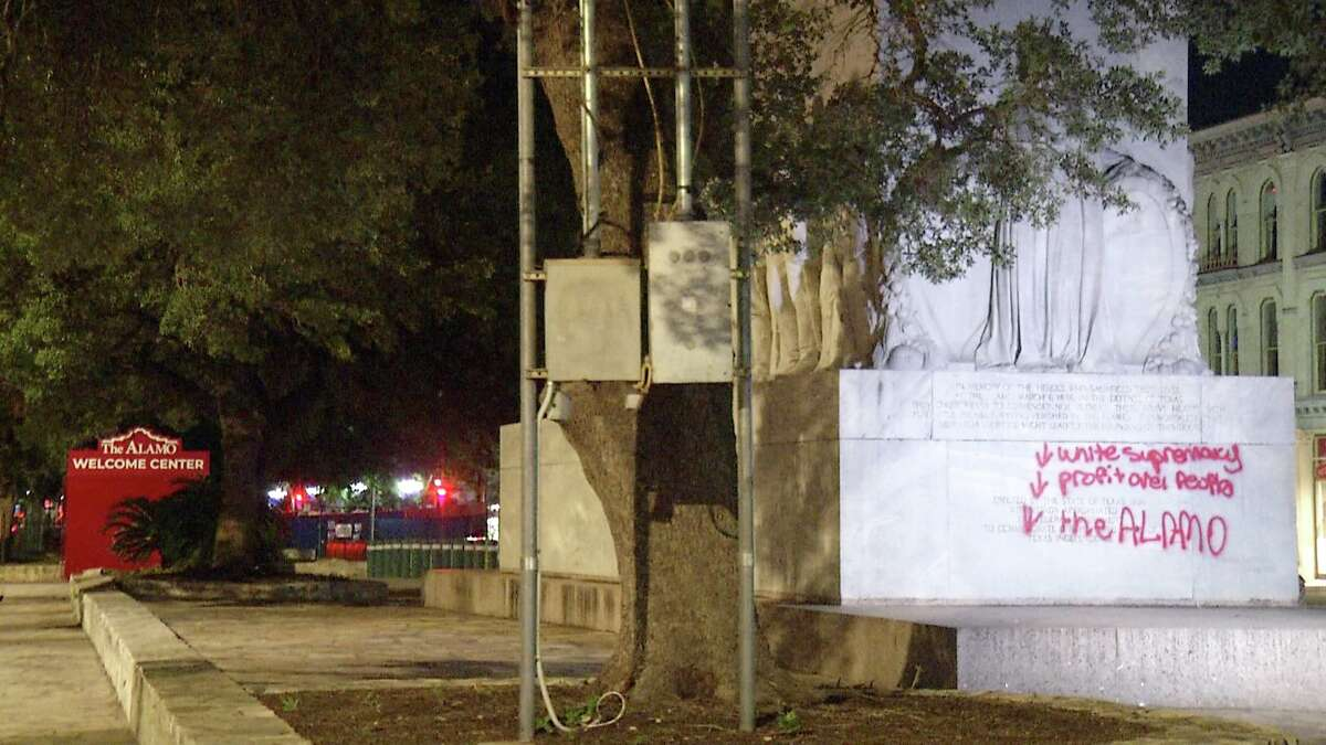 One person has been arrested after racist remarks were spray painted on the Alamo Cenotaph early Friday morning.
