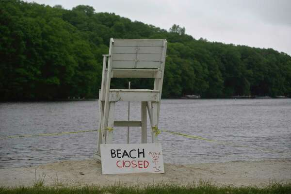 The Sherman Town Beach on Candlewood Lake is closed on Thursday afternoon. Sherman and other towns on the lake did not open their beaches for Memorial Day weekend. May 28, 2020, in Conn.