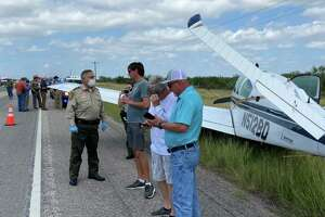 Webb County Sheriff Martin Cuellar speaks to the three occupants of a small private plane that had an emergency landing on U.S. 59, east of Laredo.