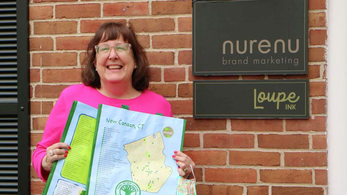 BJ Flagg at Nurenu Brand Marketing holds the reusable New Canaan grocery bags she designed for free. Bags are $4 and proceeds will benefit the New Canaan Nature Center.
