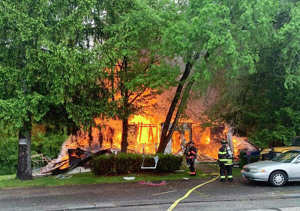 Fire crews from throughout Middlesex County were called to a two-alarm fire May 29 in the 1600 block of Saybrook Road in Middletown. South Fire District Chief Michael Howley took this photograph when he arrived at the scene just moments after the 911 call. The two residents suffered fatal burns.
