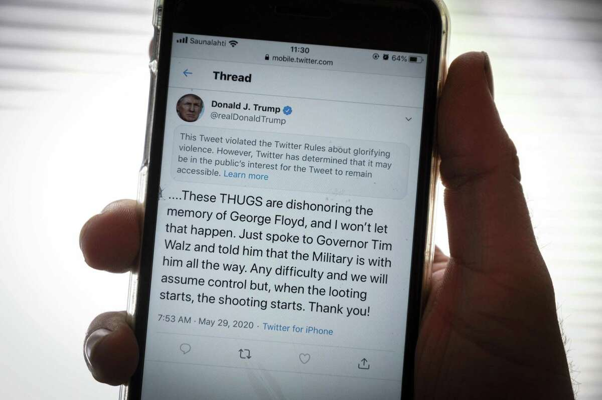TOPSHOT - The twitter page of US President Donald Trump's is displayed on a mobile phone in Vaasa, Finland, on May 29, 2020. - Twitter on May 29, 2020 flagged a post by US President Donald Trump on the unrest in Minneapolis as 'glorifying violence', saying the tweet violated its rules but would not be removed. (Photo by Olivier MORIN / AFP) (Photo by OLIVIER MORIN/AFP via Getty Images)