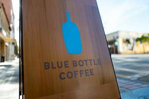 Sign for Blue Bottle Coffee on University Avenue, the main street in the Silicon Valley city of Palo Alto, California, November 14, 2017. (Photo by Smith Collection/Gado/Getty Images)