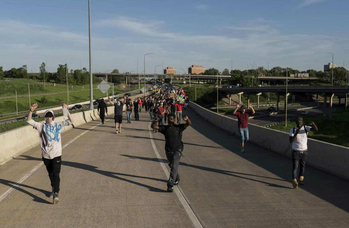 MINNEAPOLIS, MN - MAY 28: Protesters march down a highway off-ramp on May 28, 2020 on their way to Minneapolis, Minnesota. Police and protesters continued to clash for a third night after George Floyd was killed in police custody on Monday. (Photo by Stephen Maturen/Getty Images)