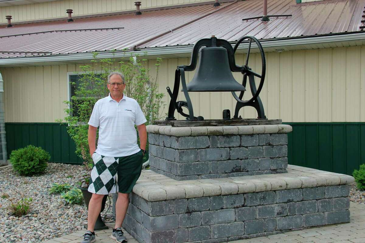 Pastor Reggie Courliss poses for a photo outside of Elkton Missionary Church. The church will be offering a drive-in service this Saturday. (Robert Creenan/Huron Daily Tribune)