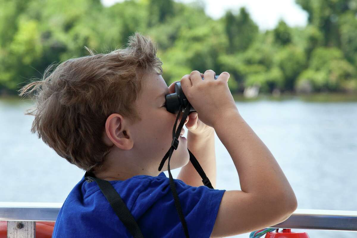 Adults and children alike enjoy the thrill of birdwatching in the Big Thicket.