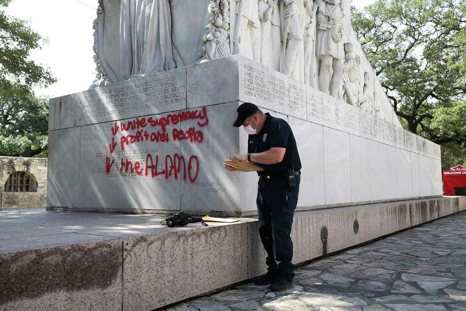 San Antonio Police Senior Crime Scene Investigator Robert Rackley takes evidence of graffiti on the Alamo Cenotaph, Friday, May 29, 2020.