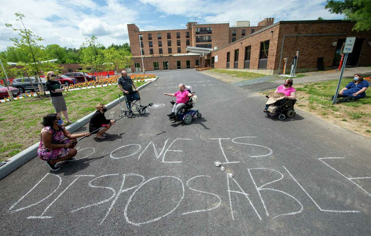 Jamie Farrar, of ADAPT Capital Region, speaks during a vigil at Shaker Place Rehabilitation and Nursing in Colonie NY on Saturday, May 23, 2020 calling on New York state to support nursing home workers, transfer residents who so choose to safer settings and step up state regulations of nursing homes (Jim Franco/Special to the Times Union.)