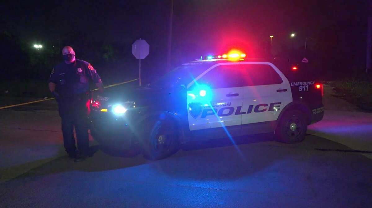 Houston police officers investigate an officer-involved shooting in the 7100 block of Cullen on Friday, May 29, 2020.
