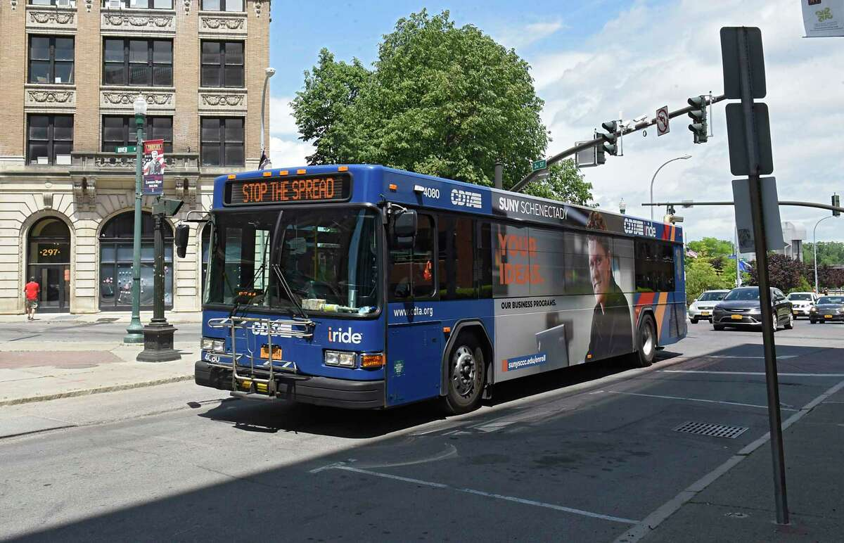 A CDTA bus is seen coming down a street on Friday, May 29, 2020 in Troy, N.Y. President Donald Trump tweeted he is committing $60.9M to a brand new bus system for a very busy and popular transit corridor in the Albany, NY area.(Lori Van Buren/Times Union)